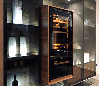 Portfolio - example of installation of a wine cabinet in a design custom-made wood showcase